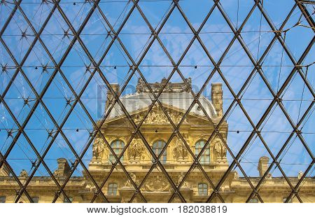 Paris France - July 4 2015: Inside the glass pyramid at the Louvre museum in Paris France