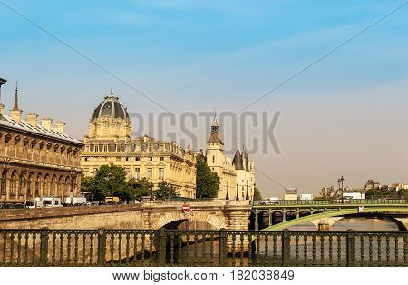 View of the Concierge in Paris France with bridges over the Seine river