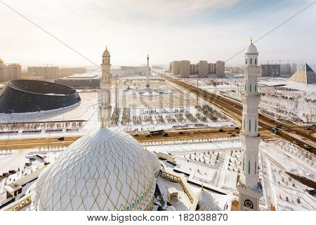 The view from the minaret of the Mosque Hazrat Sultan at the Independence Square with the Palace of Shabyt and Kazak Eli Monument in Astana, Kazakhstan