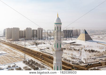 The view from the minaret of the Mosque Hazrat Sultan Presidential Park and the Palace of Peace and Reconciliation