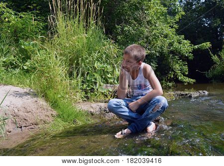 stream boyexcitement  river teen summer morning childhood village  warmth sadness reverie sand algae grove