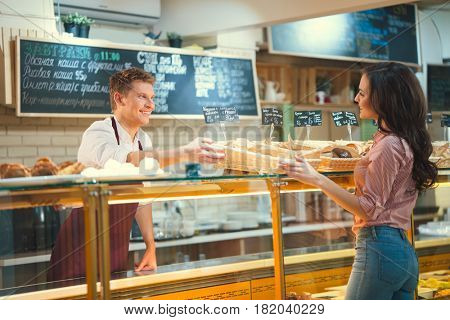 Smiling woman in bakery
