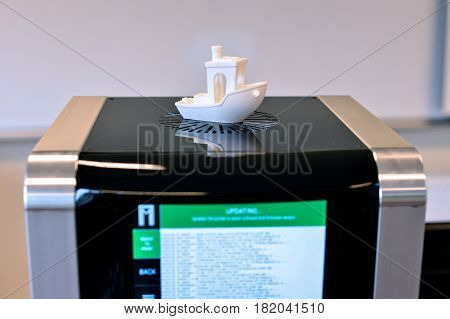 RIGA, LATVIA - MARCH 29, 2017: Two filament 3D printer updating software from Internet. New printing technology.