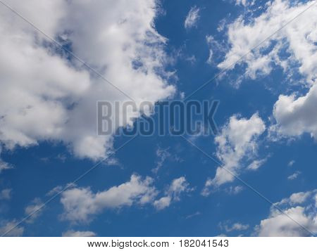 Heaven cloudscape of light white clouds against blue sky