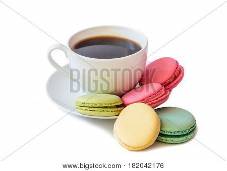 White coffee cup with colorful macaroons isolated on white background