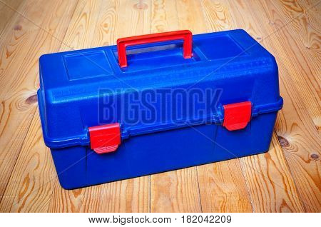Blue tools box stand on wooden background