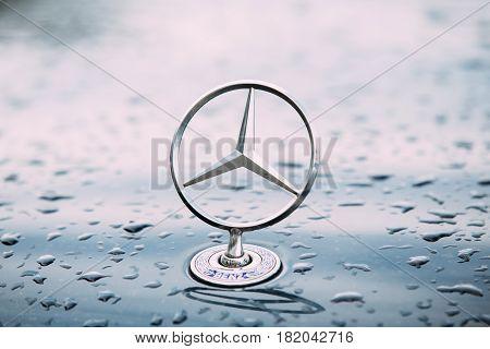 Batumi, Georgia - May 27, 2016: Close View Of  Metal Star Logo Of Mercedes Benz At Wet Hood Of Blue Car After Rain.