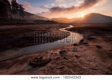Sunrise over dam Shiroka polyana Bulgaria Rhodope mountain drought