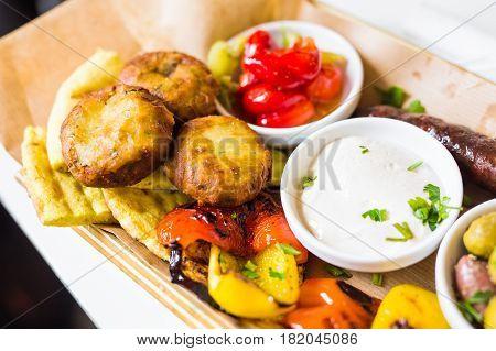 Tasty Grilled Vegetables with Fresh Green Olives.
