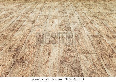 Linoleum flooring with embossed wood texture. Brown floor large area. Horizontal layout perspective.