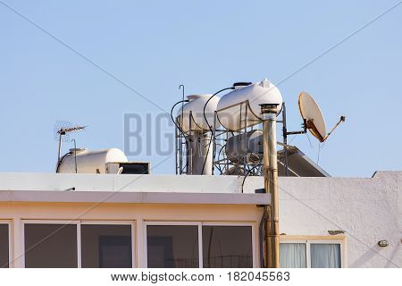 Solar Hot Water System. Solar heater for green energy. Contemporary hot water panels on a house