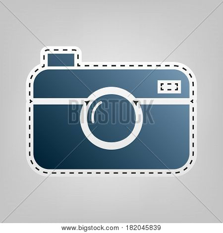 Digital photo camera sign. Vector. Blue icon with outline for cutting out at gray background.