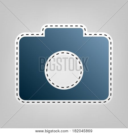 Digital camera sign. Vector. Blue icon with outline for cutting out at gray background.