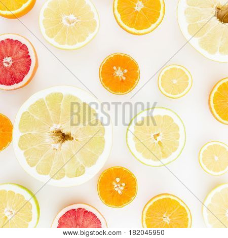 Tropical summer mix with fresh lemon, orange, mandarin, grapefruit and sweetie on white background. Flat lay, top view.