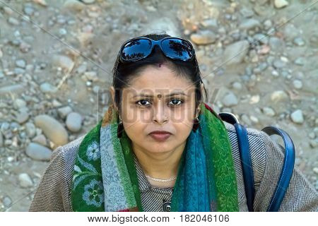 Woman looking up with curiosity in Corbett Tiger Reserve