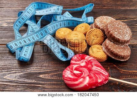 Cookies, lollipop and measuring tape. Think before you eat.