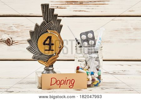 Drugs, award and syringe. Physical activiy with doping.