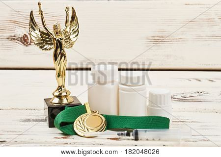 Awards and containers with pills. How to win at sport.