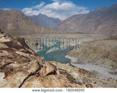 Confluence of Indus and Gilgit Rivers in Northern area of Pakistan Where Karakoram, Hindukush And Himalayan Ranges Meet