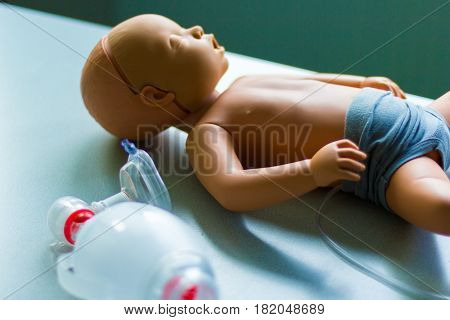 a medical child puppet lies on a table