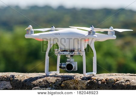 White Drone landed on a wall. Stopped drone