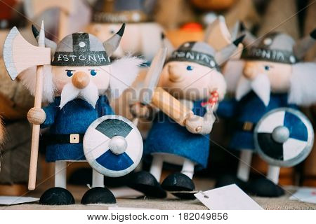 Tallinn, Estonia - December 2, 2016: Traditional Souvenirs Ethnic Folk National Wooden Viking Dolls Toys At European Estonian Market. Popular Souvenir From Tallinn, Estonia