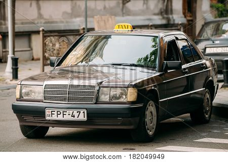 Batumi, Adjara, Georgia - May 27, 2016: Old car 1996 Mercedes-Benz 190 E W201 sedan taxi parking on street. First compact executive car from Mercedes-Benz introduced in 1982, positioned below the E-Class