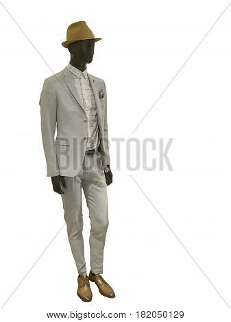 Full length male mannequin dressed in gray suit and brown hat isolated on white background. No brand names or copyright objects.