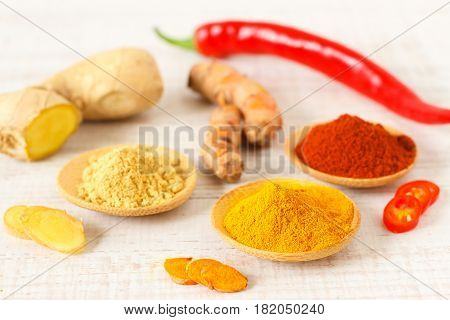 Oriental mix of fresh and dry spices on a table