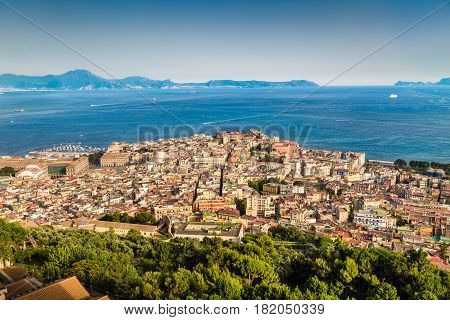 Scenic Picture-postcard View Of The City Of Napoli (naples) With The Gulf Of Naples In Golden Evenin