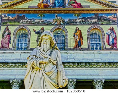 Rome, Italy - September 10, 2015: The outside view of Basil of St. Paul at Rome, Italy with palm trees at Rome, Italy on September 10, 2015