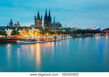 COLOGNE, GERMANY - JUNE 17, 2015: Great St. Martin Church And Dom In Cologne At Evening With Reflection In River Rhine.