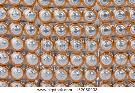 background from large group of orange batteries
