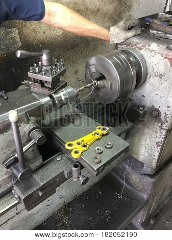 CNC lath machine (CNC Turning machine) while cutting steel metal shaft processing on lathe machine in workshop
