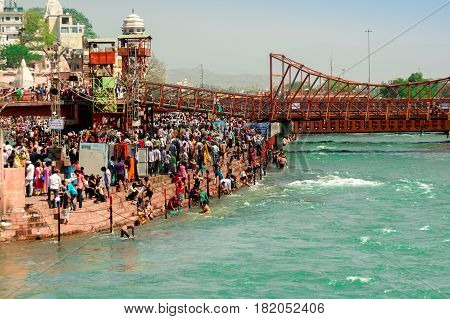 Haridwar, India - 2nd Apr 2017 : Crowds on the banks of the river Ganga at Har ki Pauri. This is one of the most holy places in Hinduism. Place to wash away sins.