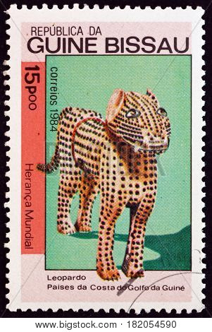 GUINEA-BISSAU - CIRCA 1984: a stamp printed in Guinea-Bissau shows Wood Sculpture of Leopard Guinea Coast World Heritage circa 1984
