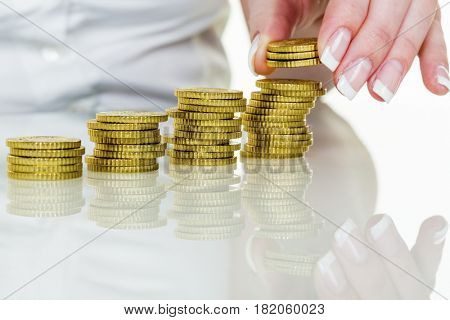 save woman with stack of coins in the money