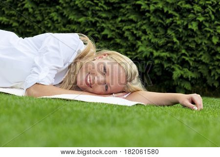 woman lying to rest in the meadow
