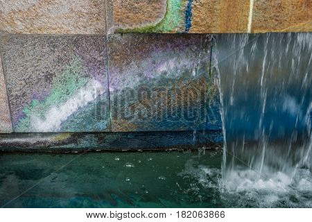 A macro shot of a colorful fountain in West Seattle Washington.