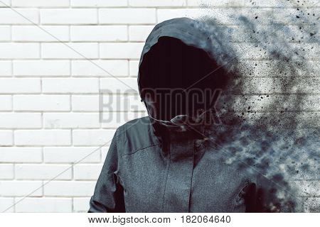 Thinking mind blowing thoughts faceless hooded person against white brick wall