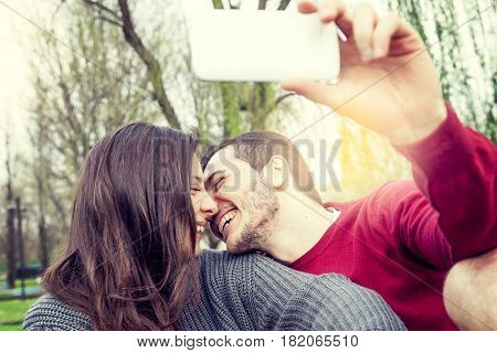 Nice Couple Boyfriends Takes A Selfie Relaxing  On Deckchair Outdoor