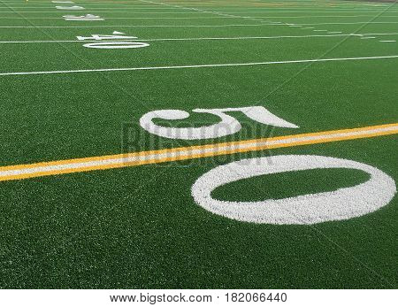 Bright green artificial  turf with white letters