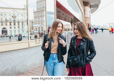 Happy women talking and laughing in city