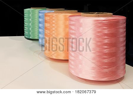 Closeup of spools of thread and colored sewing for the textile industry