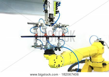 Industrial robot with vacuum suckers conveys the plastic part