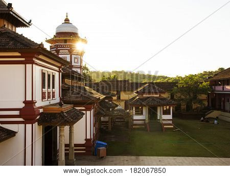 temple in Goa, India and beautiful sunset throuth the roof.