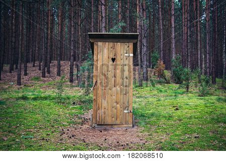 Outhouse in forest Dziemiany commune of Cassubia region in Poland