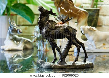 MOSCOW, RUSSIA - OCT 28, 2016: Metal figurine of roaring elk at private collection.