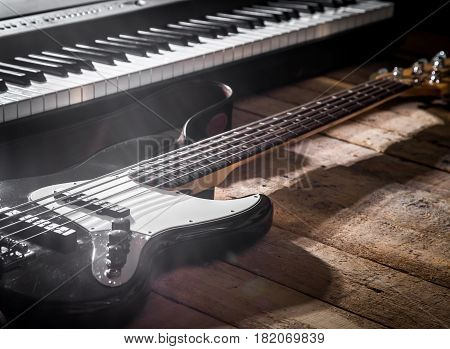Piano And Guitar On Wooden Background Closeup
