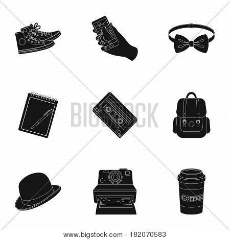 A set of icons about the style of a hipster. A peculiar youth style. Hipster style icon in set collection on black style vector symbol stock web illustration.